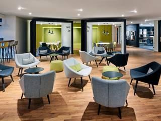 HÄCKER KÜCHEN - Showroom / Hausmesse Moderne Geschäftsräume & Stores von MOYSIG RETAIL DESIGN GMBH Modern