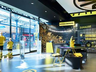 Fanshop BVB 09 Borussia Dortmund Moderne Geschäftsräume & Stores von MOYSIG RETAIL DESIGN GMBH Modern