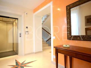 Modern corridor, hallway & stairs by Borea immobiliare Modern