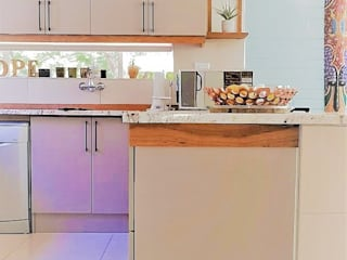Eclectic Kitchen With Striking Solid Teak Detail by Zingana Kitchens and Cabinetry Modern
