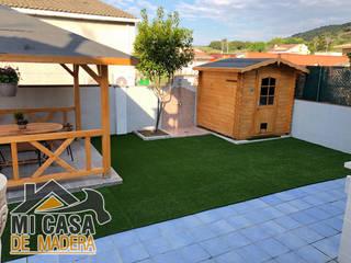 Caseta de madera Vivian 3,8m2:  de estilo  de MI CASA DE MADERA - SOLICITA PRESUPUESTO info@micasademadera.com