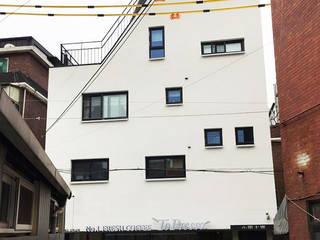 Maisons de style  par 건축사사무소 지음