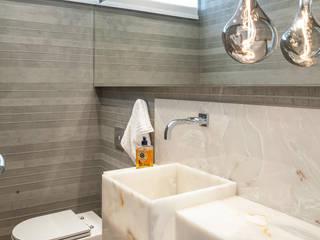 Lavabo Barra : Banheiros  por Ana Cano Milman arquitetura e design de interiores