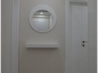 Pasillos y recibidores de estilo  por Bünyamin Erdemir Tasarım ve Uygulama