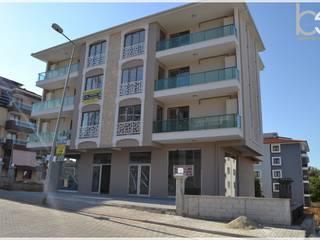 Casas multifamiliares de estilo  por Bünyamin Erdemir Tasarım ve Uygulama