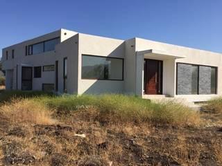 Maison individuelle de style  par Arqsol, Moderne