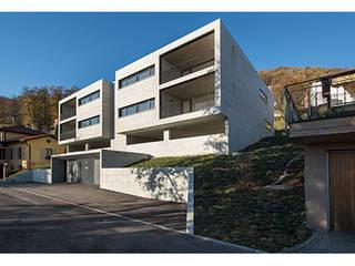 Bigorio Housing in Lugano, TI, Switzerland: Habitações multifamiliares  por Natalia Bencheci,Moderno