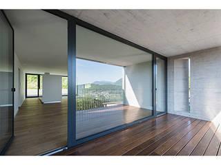 Bigorio Housing in Lugano, TI, Switzerland: Habitações multifamiliares  por Natalia Bencheci