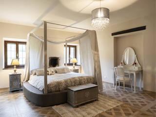 Il Mulino Camera da letto coloniale di Biondi Architetti Coloniale