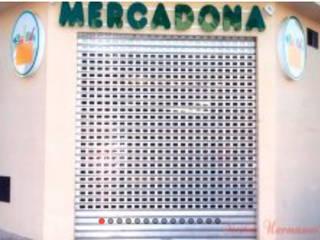 Persianas automáticas y cierres metálicos:  de estilo industrial de Sicilia Hermanos, Industrial