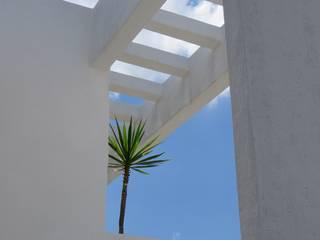 fachada laterial: Casas unifamiliares de estilo  por Arquenta, Arquitectura de Diseño