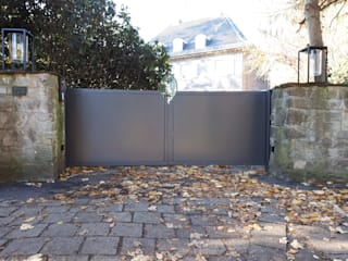 Jardines delanteros de estilo  de Schmiedekunstwerk GmbH