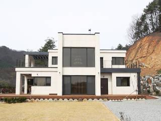 삶이 즐거워지는 철근콘크리트 주택 (경기도 양평군) by 더존하우징 모던
