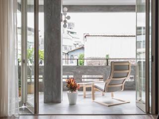 Balcones y terrazas eclécticos de 湜湜空間設計 Ecléctico