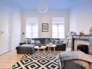 Renovación y ampliación de una casa unifamiliar en Bruselas Salones de estilo escandinavo de Isabel Gomez Interiors Escandinavo