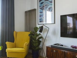 klimatyczne mieszkanie na Saskiej Kępie Nowoczesny salon od JJJASKOLA ARCHITEKCI Nowoczesny