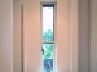 自宅兼美容室のボウル: 滝沢設計合同会社が手掛けたキッチンです。