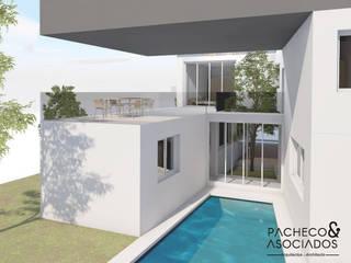 Piscina y jardín: Casas multifamiliares de estilo  de Pacheco & Asociados
