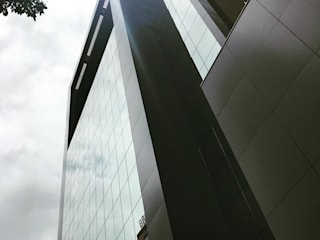 Edificio Golden Offices: Casas  por Marcelo Sena Arquitetura