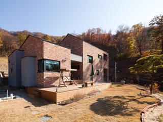Casas de campo de estilo  por 위드하임, Moderno