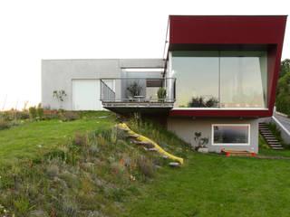 Haus am Weinberg - Einfamilienhaus Moderner Garten von LOSTINARCHITECTURE Modern