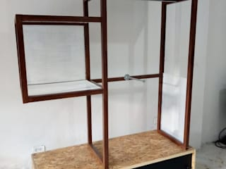Diseño y Montaje - Interior- Comercial Vestidores de estilo industrial de CUSTOM WORK DISEÑO Industrial