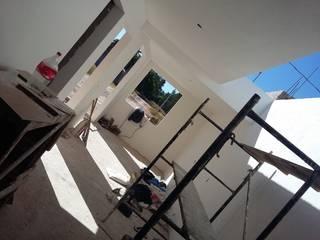 Casa la Huerta : Casas de estilo  por Simbiothink Arquitectura