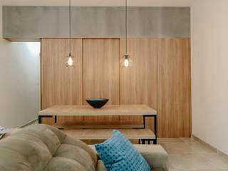 Reforma apartamento Major Salas de jantar industriais por ARAMADO arquitetura+interiores Industrial
