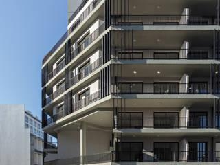 Proyecto de Viviendas para la Villa Olímpica: Casas multifamiliares de estilo  por SMF Arquitectos  /  Juan Martín Flores, Enrique Speroni, Gabriel Martinez