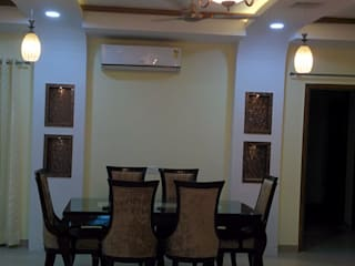 Dr. Anju's residence Rustic style dining room by Design Kreations Rustic