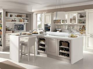 Ilha em L com garrafeira incorporada:   por Area design interiores - cozinhas em Braga