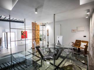 Estudio Diseño De Interiores JUANCHO GONZALEZ Oficinas y tiendas de estilo industrial