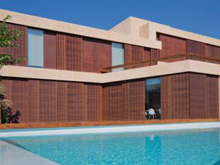 Modern houses by GIMÉNEZ GANGA Modern