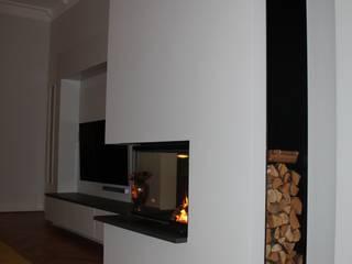 Christoph Lüpken Ofenbau GmbH - Kamine aus Duesseldorf Salones de estilo moderno