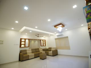 Living room interior designing:   by Qubes Modular Interior Designs