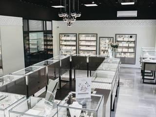Создание корпоративного стиля ювелирной компании Офисы и магазины в стиле модерн от Studio architecture and design LAD.Студия архитектуры и дизайна ЛАД . Модерн