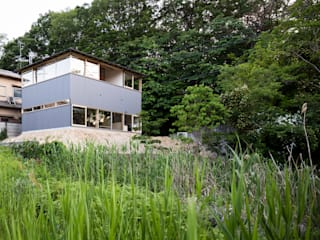Modern houses by KOMATSU ARCHITECTS Modern