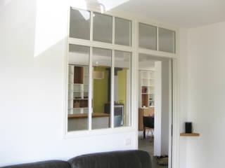 Verrière: Salon de style  par One look inside