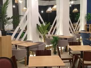 Hoteles de estilo  por GrupoSpacio constructores en Madrid, Moderno