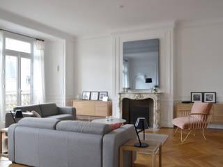 Appartement familial - Paris 17 / 200 m²: Salon de style  par A comme Archi
