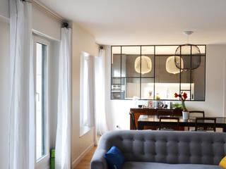 Appartement familial - Levallois / 130 m²: Salon de style  par A comme Archi