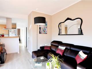 Rehabilitación y adecuación de un piso en Barcelona: Salones de estilo  de JSV-Architecture