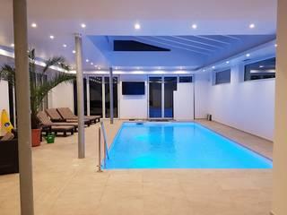 by AH BADDESIGN GMBH Schwimmbad & Saunabau Modern