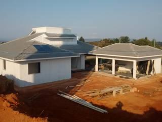 Administração de Obra: Condomínios  por Eric Harada - Projetos e Construções,Moderno