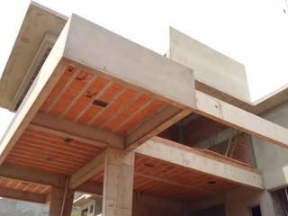 Acompanhamento de Obra: Condomínios  por Eric Harada - Projetos e Construções,Moderno
