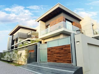 Modern house Exterior:  Houses by Planet Design and associate