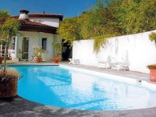 by AH BADDESIGN GMBH Schwimmbad & Saunabau Mediterranean