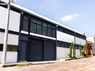 16. BODEGA OFICINAS: Casas de estilo  por TARE arquitectos