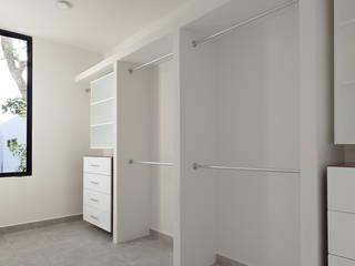 vestidor Vestidores modernos de Daniel Cota Arquitectura | Despacho de arquitectos | Cancún Moderno Madera Acabado en madera