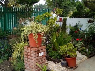 Diseño de jardin exterior A - Evolución:  de estilo  por DUSINSKY S.A.